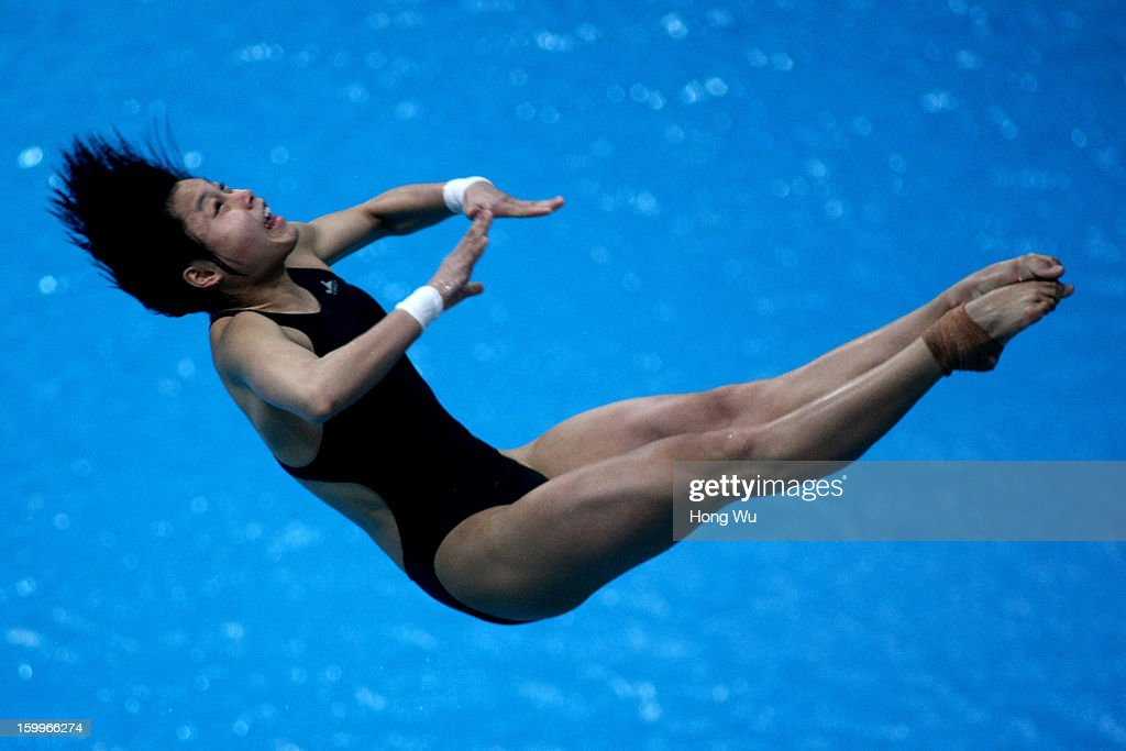 Chunting Wu of China competes in the Women's 3m Springboard Diving Final on Day 2 of the 2013 China Diving Champions Cup at Jinan Olympic Sports Center on January 24, 2013 in Jinan, China.