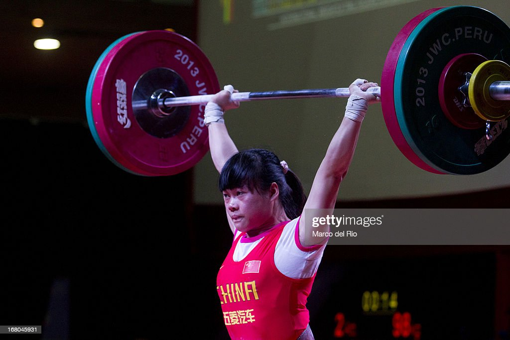 Chunying Guan of China A competes in the Women's 48kg clean and jerk during day one of the 2013 Junior Weightlifting World Championship at Maria Angola Convention Center on April 04, 2013 in Lima, Peru.