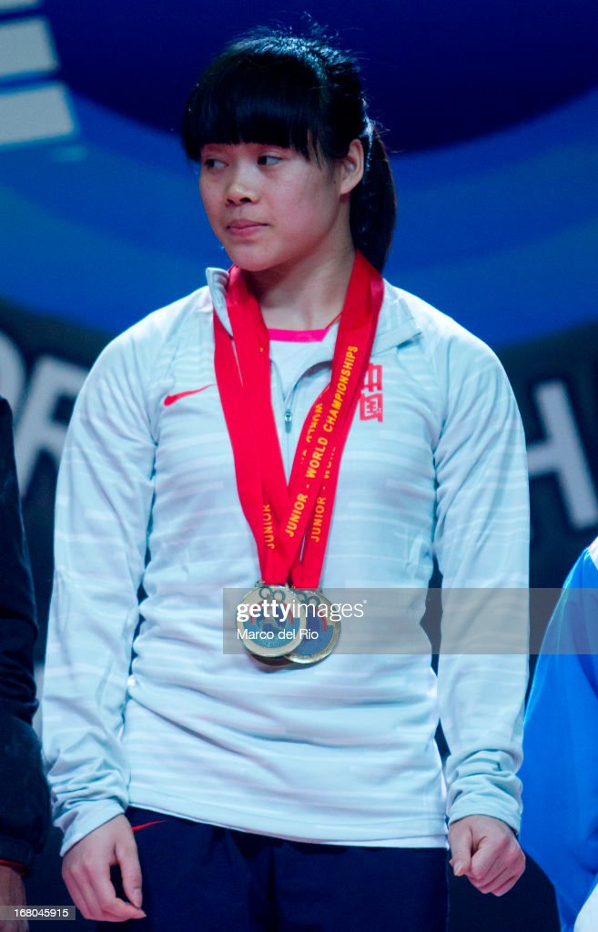 Chunying Guan of China A receives three golden medals (Snatch, cleand jerk and total) during the Women's 48kg podium on day one of the 2013 Junior Weightlifting World Championship at Maria Angola Convention Center on April 04, 2013 in Lima, Peru.