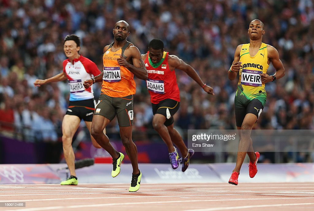 Churandy Martina of Netherlands and Warren Weir of Jamaica compete in the Men's 200m Semifinals on Day 12 of the London 2012 Olympic Games at Olympic...