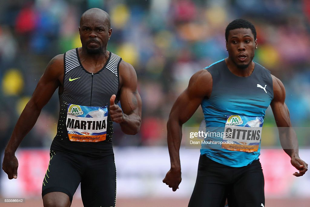 Churandy Martina of the Netherlands and Ramon Gittens of Barbados compete in the mens 100m during the AA Drink FBK Games held at the FBK Stadium on...