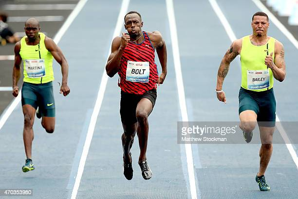 Churandy Martina of the Netherlands Usain Bolt of Jamaica and Ryan Bailey of the United States compete in the Mano a Mano Athletics Challenge at...