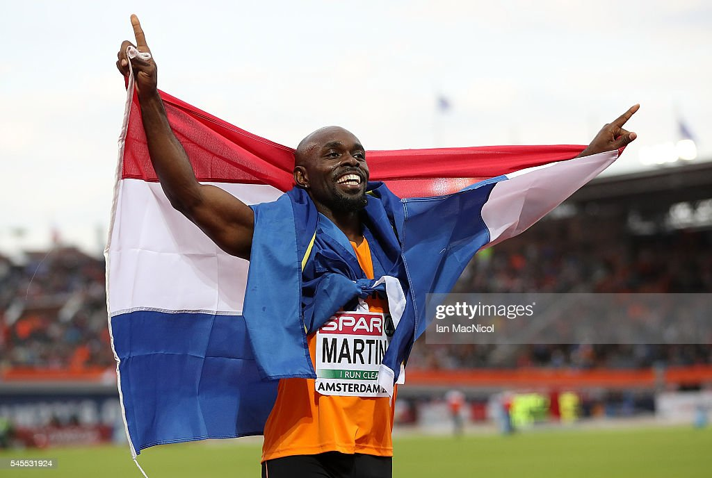 Churandy Martina The Netherlands celebrates winning gold before later being disqualified in the final of the mens 200m on day three of The 23rd...