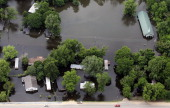 A church and homes are seen in the Mississippi River floodwaters on May 23 2011 in Vicksburg Mississippi Floodwaters are beginning to gradually...
