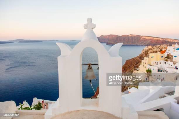 Church bell tower in Oia village, Santorini, Cyclades, Greece