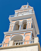 Low angle view of church bell tower in the Greek island of Santorini on the Aegean sea.