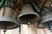Three large church bells made of copper.