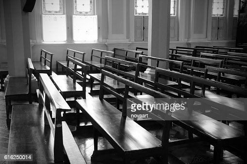 Church benches in monochrome with light. : Foto de stock
