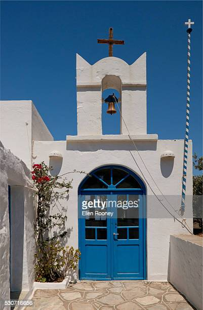 Church building with bright blue door; Sifnos, Cyclades, Greek Islands, Greece