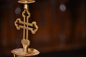 Candlestick in a shape of a cross