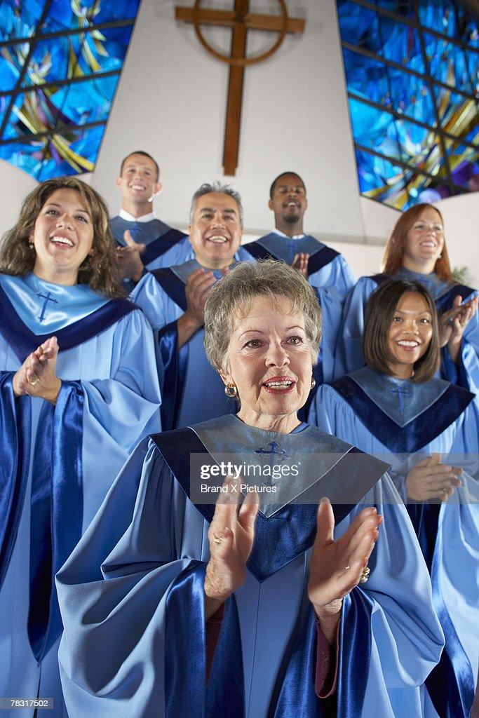 Church choir clapping hands