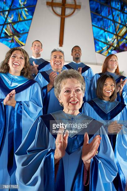 Church choir clapping hands