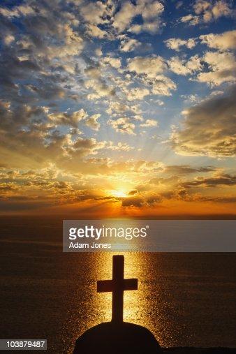 Church cross at sunset