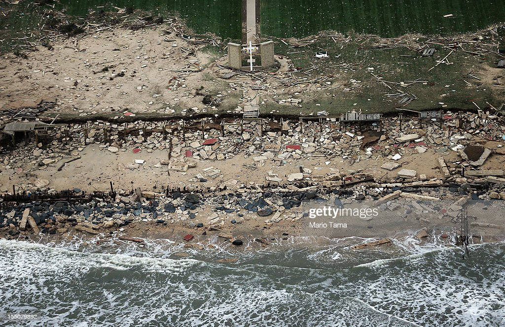 A church cross (Top C) stands amid wreckage from Superstorm Sandy at the edge of the Atlantic Ocean on October 31, 2012 in Long Branch, New Jersey. At least 50 people were reportedly killed in the U.S. by Sandy with New Jersey suffering massive damage and power outages.