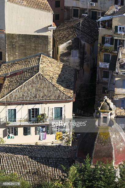 Church dome homes with washing lines among rooftops in Kerkyra Corfu Town Greece