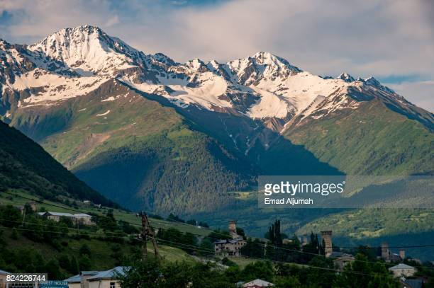 Church in Mestia village in Svaneti region of Georgia with the Caucasus mountains in the bcakground - June 28, 2017