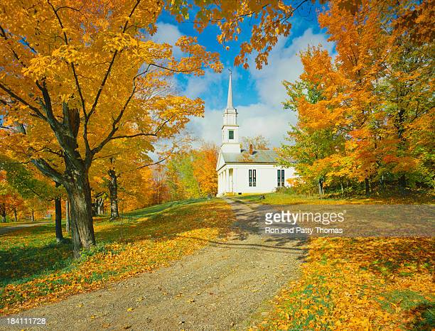Church in the distance with beautiful fall trees