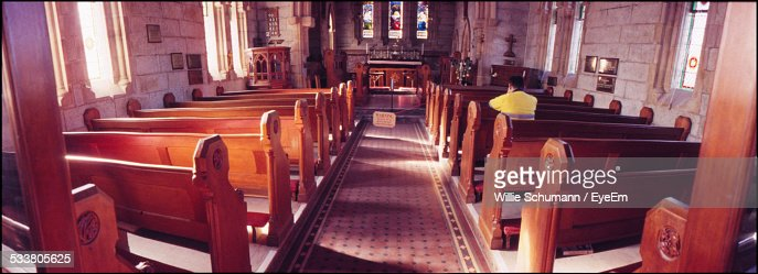 Church Interior With Stained Glass And Wooden Paws