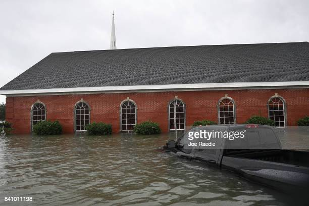 A church is surrounded by water after the flooding of Hurricane Harvey inundated the area on August 30 2017 in Port Arthur Texas Harvey which made...