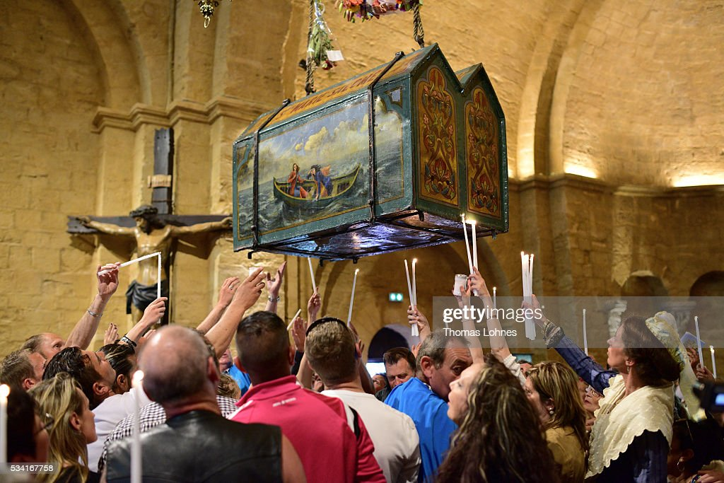 Church members and gypsies sing and pray while the casket with the reliquary of the local saintes Mary Salome and Mary Jacobe is lifted on May 25, 2016 in Saintes-Maries-de-la-Mer near Arles, France. Gypsies from all over Europe worship 'Sara the Black', their Saint and patroness, for one week. Sara's statue is situated in the crypt of the church.