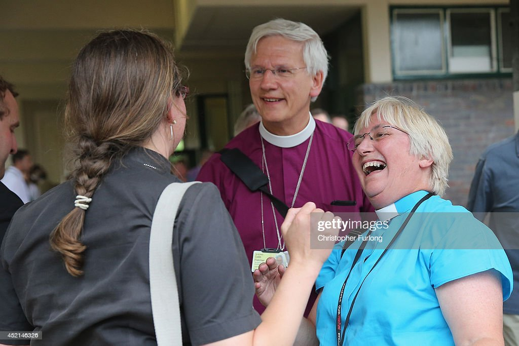 Church of England clergy celebrate after the Church of England General Synod gave their backing to the ordination of women bishops at York University on July 14, 2014 in York, England. Members and officers of the Church of England's General Synod have voted in favour to introduce women bishops. The first women bishops could be announced and ordained within the next year.