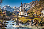 Parish Church of St. Sebastian at sunrise in fall, Ramsau, Nationalpark Berchtesgadener Land, Upper Bavaria, Germany.