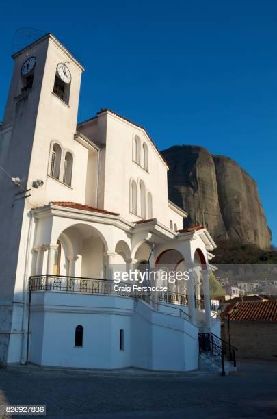 Church of Saints Peter and Paul below huge rock mountain.