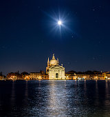 Church of the Santissimo Redentore at night with moon in beautiful city Venice