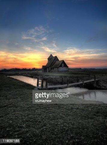 Church on  marsh at sunset