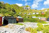Beach huts on the the beach at Church Ope Cove, Isle of Portland Dorset England UK