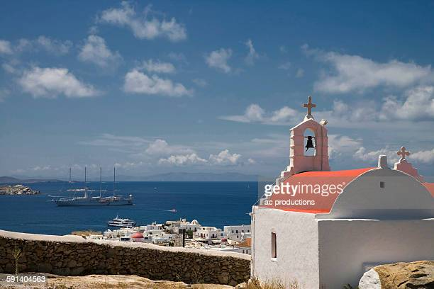 Church overlooking cityscape and ocean, Mykonos, Cyclades Islands, Greece
