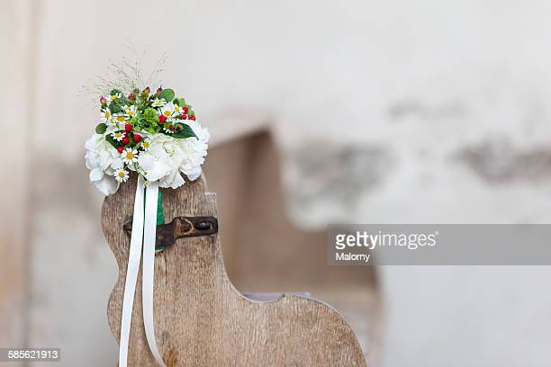 Church pew decorated with flowers for a wedding