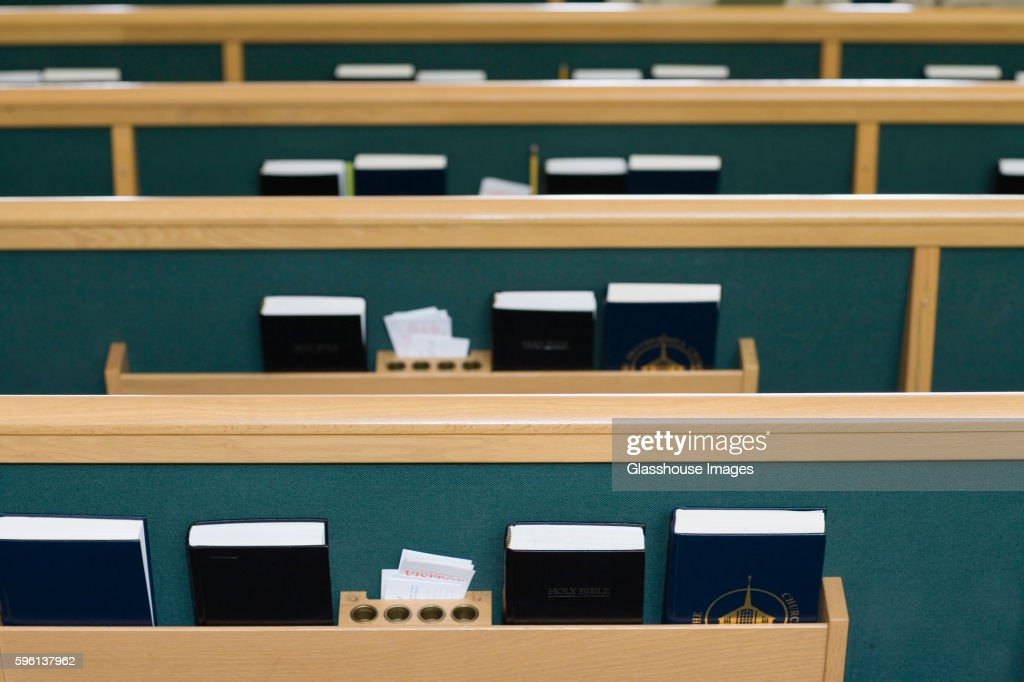 Church Pews with Bibles and Hymnals