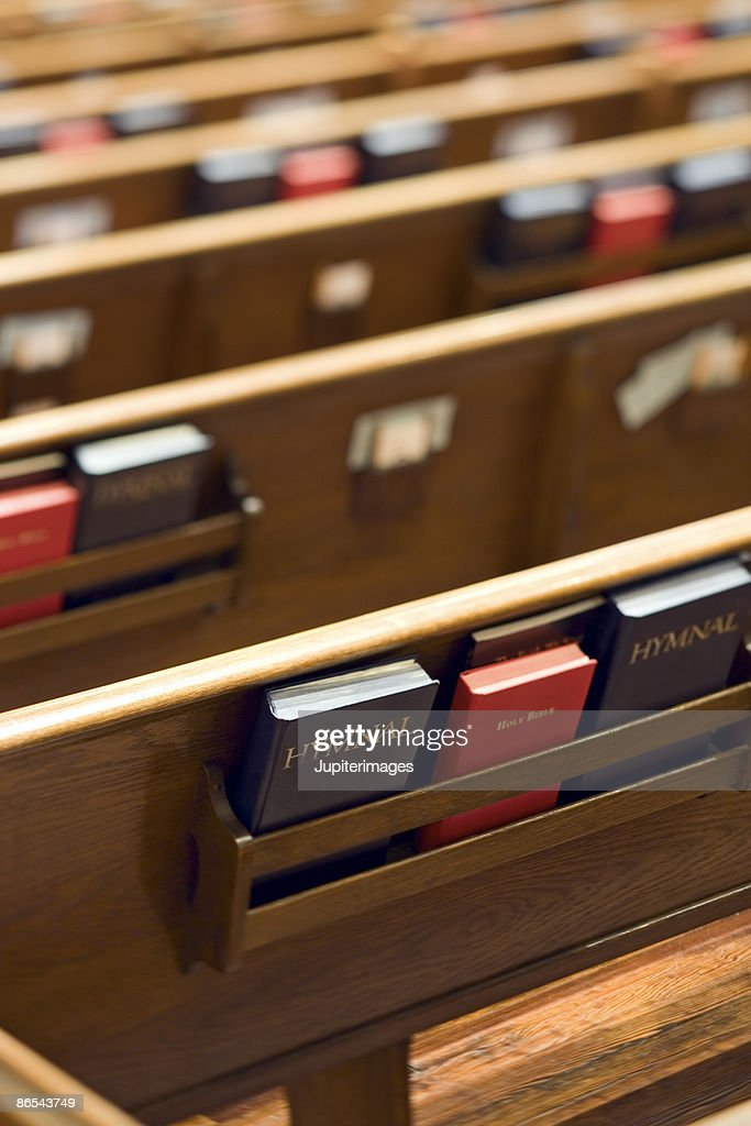 Church pews with holy bibles