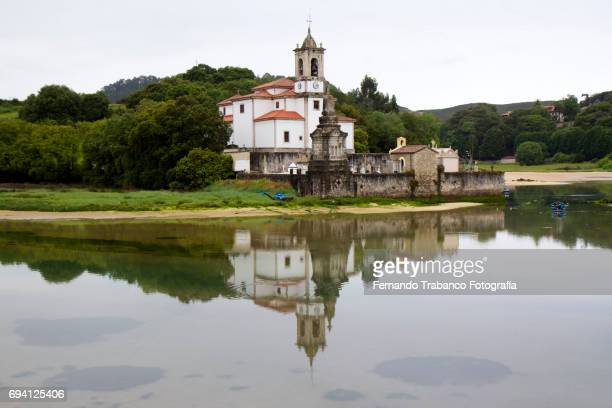 Church reflected in the water of the beach