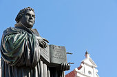 """""""Monument of Martin Luther in Wittenberg, Germany. It was the first public monument of the great reformer, designed 1821 by Johann Gottfried Schadow. Martin Luther (1483-1546) was a German monk, theol"""