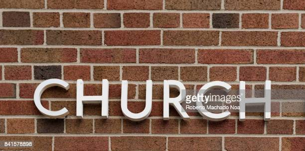 Church sign on a red brick vintage wall