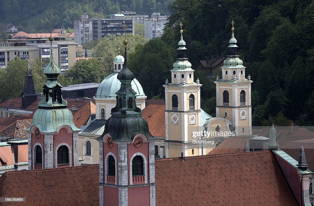 Church spires stand on the city skyline in the old town of Ljubljana, Slovenia, on Tuesday, May 7, 2013. Slovenia plans to increase taxes to make up for the swelling budget shortfall as the country works to recapitalize its banks. Photographer: Chris Ratcliffe/Bloomberg via Getty Images