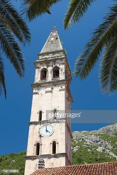 Church tower through palm fronds, Perast