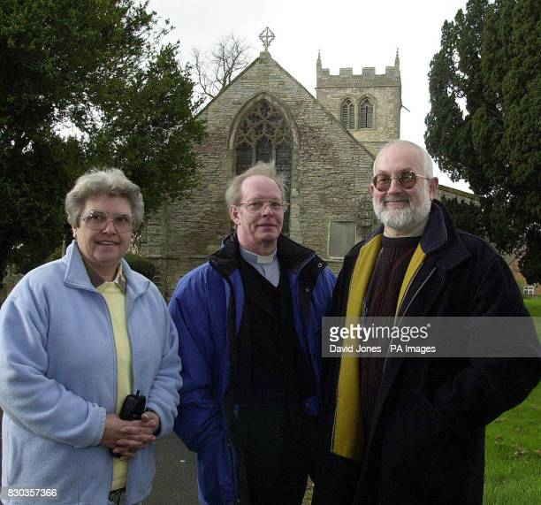 Church wardens Carole Evans and John Martin with the vicar Rev Keith Harrison by the parish church of St John the Baptist in Warwickshire as a High...