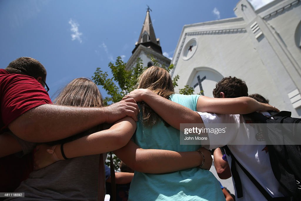 A church youth group from Douthan, Alabama prays in front of the Emanuel AME Church on the one-month anniversary of the mass shooting on July 17, 2015 in Charleston, South Carolina. Visitors from around the nation continue to pay their respects at a makeshift shrine in front of the church, in a show of faith and solidarity with 'Mother Emanuel', as the church is known in Charleston. Nine people were allegedly murdered on June 17 by 21-year-old white supremacist Dylann Roof, who was captured by police in North Carolina the following day. He is scheduled to go to trial July 11, 2016.
