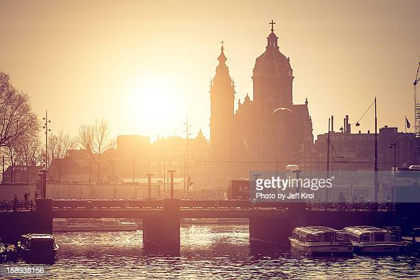Churches and a bridge at dawn with sun in the back