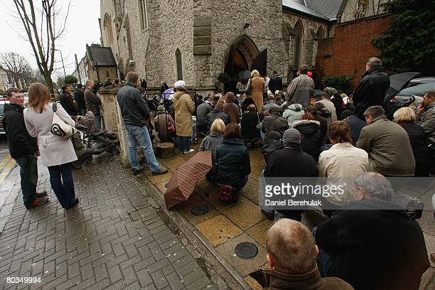 Churchgoers from the Polish community are forced to stand outside the crowded church as they attend an Easter Sunday mass at the 'Our Lady Mother of...