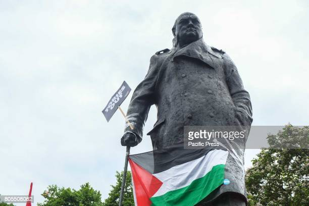 Churchill is draped in the Palestinian Flag Thousands of protesters march through London and rally in Parliament Square calling for a change in...