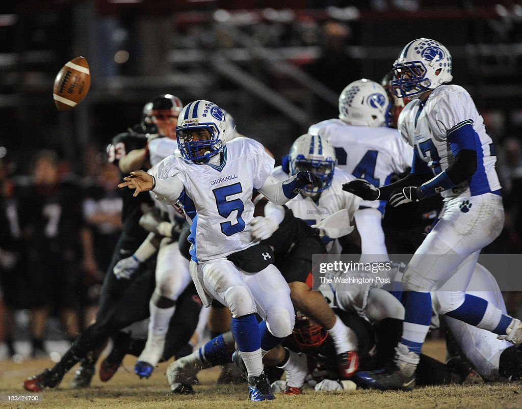 Churchill quarterback Lansana Keita pitches the ball during the MPSSAA 4A West region final at Quince Orchard High School on Friday, November 18, 2011. Quince Orchard defeated Churchill 23-21 with a field goal as time expired. Photo by Toni L. Sandys/Washington Post)