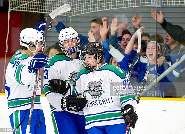 Churchill teammates Philip Satin left and Justin Vagonis center celebrate with Andrew Kurapov right after he scores the team's fifth goal at the...