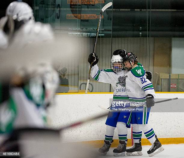 Churchill's Andrew Kurapov right celebrates with Trevor Dixon left after he scores in the second period to bring the score to 31 as Wootton plays...
