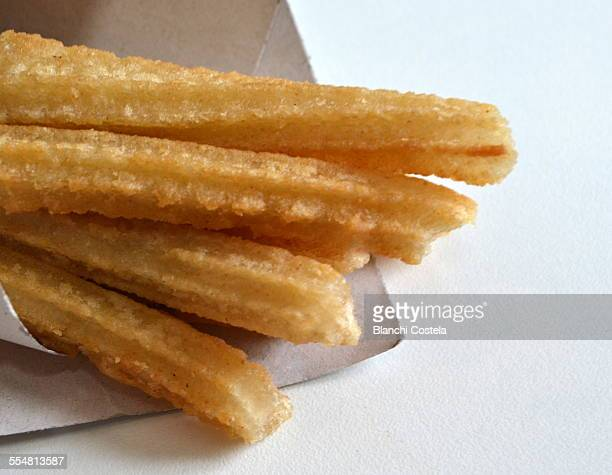 Churros with sugar on white background