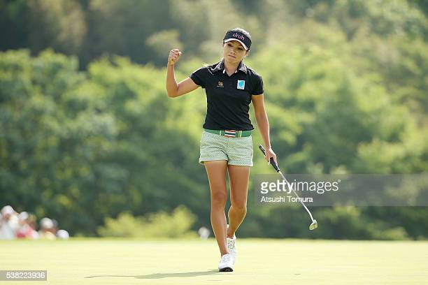 Chutichai of Thailand celebrates after making her par putt on the 18th green during the final round of the Yonex Ladies Golf Tournament 2016 at the...