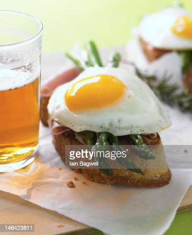 ciabatta with asparagus, prosciutto, egg : Stock Photo